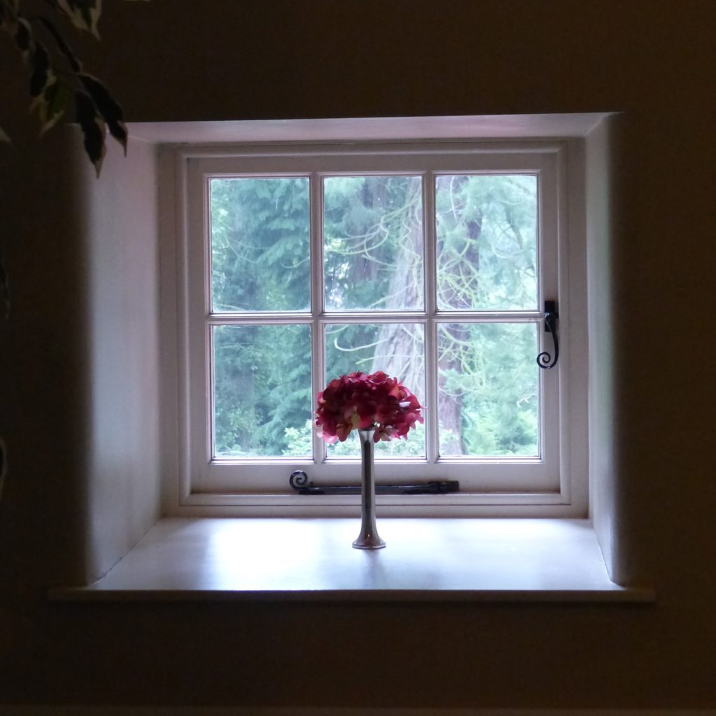 house window with flower vase