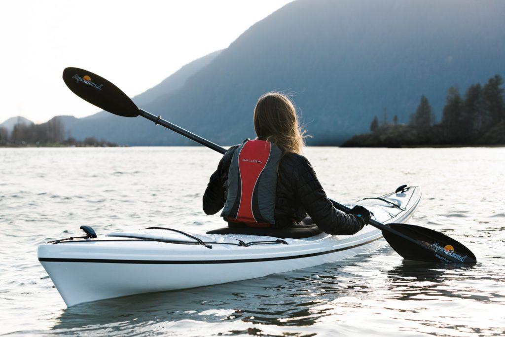 woman kayaking on a lake
